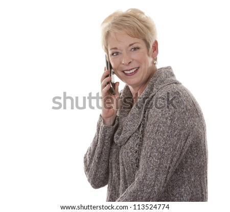 casual blond woman in her fifties using phone on white isolated background - stock photo