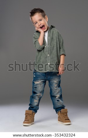 Casual boy with smile over a grey background  - stock photo