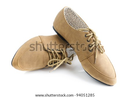 Casual brown leather lady shoes on white - stock photo