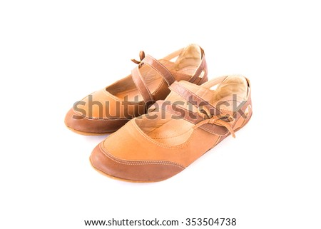 Casual brown leather lady shoes on white background