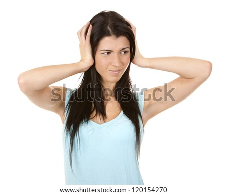 casual brunette showing silence gesture on white background