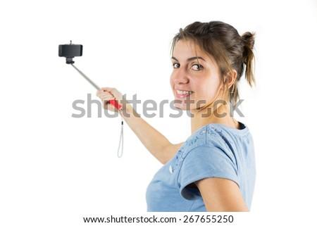 Casual brunette taking a selfie shot in studio - stock photo