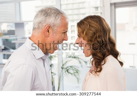 Casual business colleagues having an argument in the office - stock photo