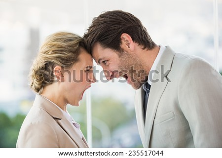 Casual business colleagues in argument at work - stock photo
