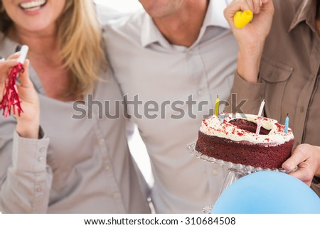 Casual business people celebrating birthday in the office - stock photo