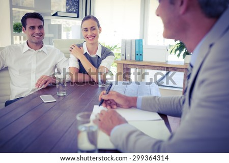 Casual business people speaking together in office - stock photo