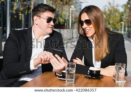 Casual business talk over coffee