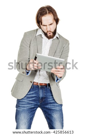 Casual Businessman playing at a digital tablet, isolated in white.