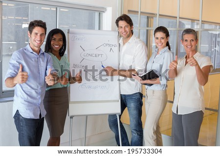 Casual businessman presenting his ideas in the office - stock photo