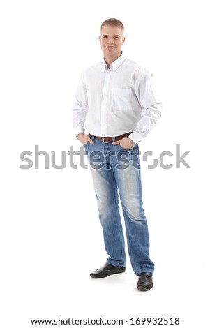 Casual businessman standing with hands in pocket, smiling at camera, cutout, full size. - stock photo
