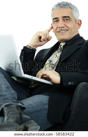 Casual businessman thinking leaning on hand, using laptop computer. Isolated on white.