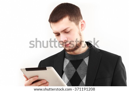 Casual businessman using his tablet  isolated on white - stock photo