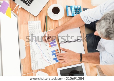 Casual businessman working on wooden desk in the office