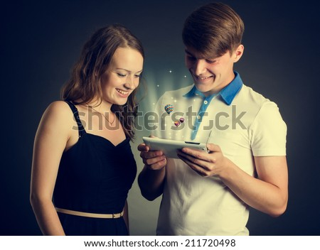casual caucasian smiling young couple  using tablet.