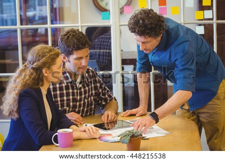 Casual colleagues using a tablet in the office - stock photo