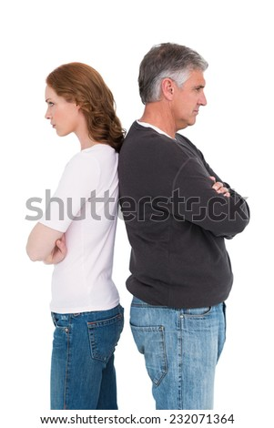 Casual couple not speaking after fight on white background