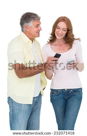 Casual couple sending text messages on white background - stock photo