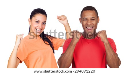 Casual couple with red and orange t-shirt celebrating something isolated on a white background - stock photo