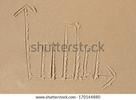 Casual drawing of a bar chart in the wet beige sand of a sunlit beach. Ideal as business concept illustration for online marketing or professional services purposes. - stock photo