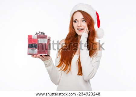Casual dressed sexy redhead woman in Santa hat with beautiful smile isolated on white background  - stock photo