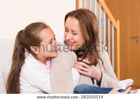 Casual family portrait of happy cheerful mother with smiling daughter - stock photo