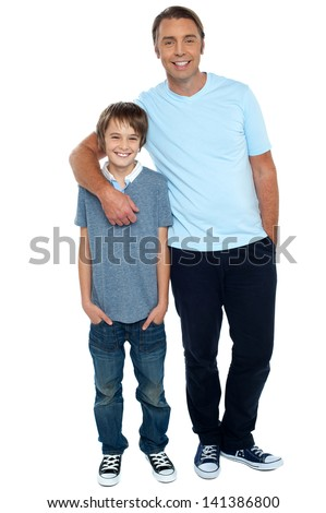 Casual full length shot of a father and son - stock photo