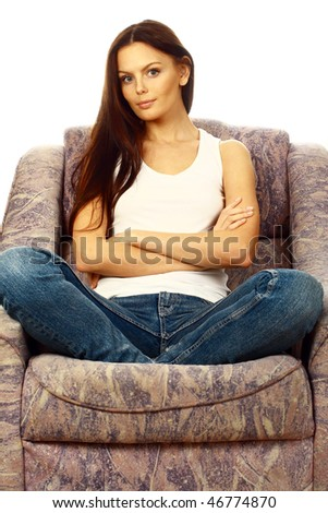 Casual girl in a soft armchair. - stock photo