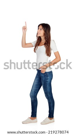 Casual girl pointing something isolated on a white background