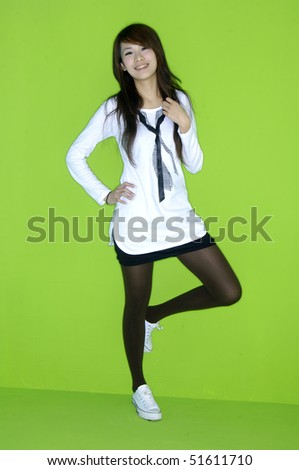 casual girl standing up over a  green