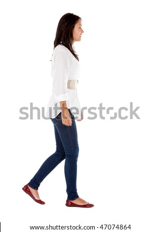 Casual girl walking isolated over a white background - side view