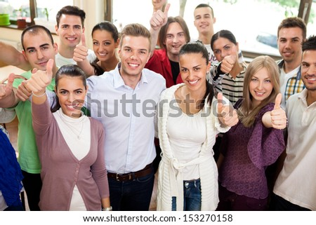 Casual group of students looking happy and smiling - stock photo