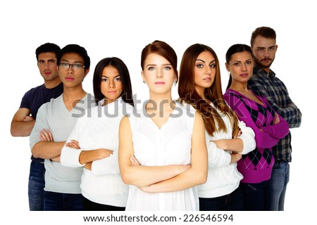 casual group of young serious people looking at the camera on white background - stock photo