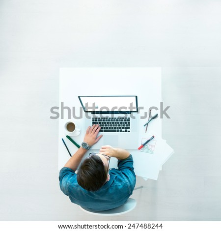 Casual Guy working on laptop - stock photo