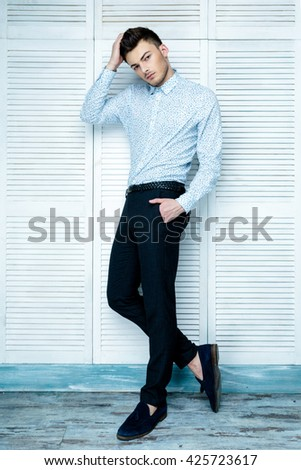 Casual handsome attractive portrait  of mature businessman wearing blue shirt