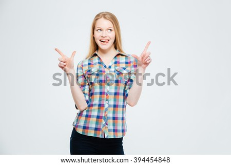 Casual happy thoughtful woman standing isolated on a white background - stock photo