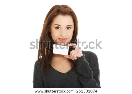 Casual happy woman showing business card - stock photo