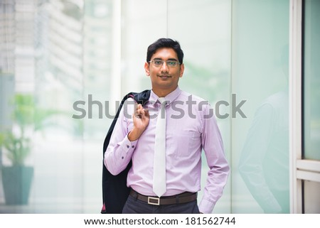 casual indian business male with coat off - stock photo