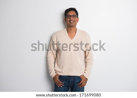 casual indian male in a sweater - stock photo