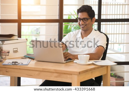 casual indian male working at office