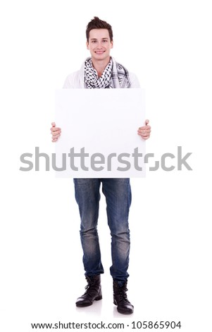 casual man displaying a banner ad isolated over a white background - stock photo