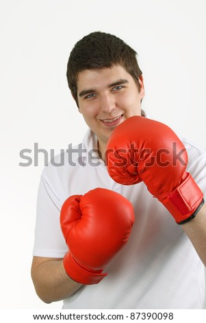 Casual man in red boxing gloves. Isolated over white background.