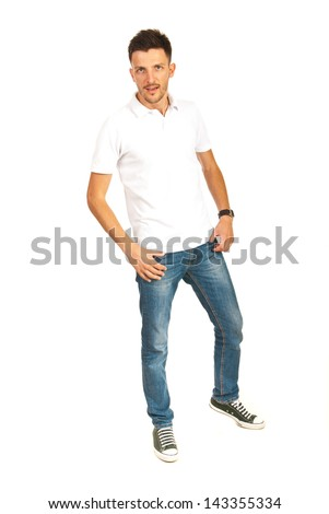 Casual man in white t-shirt and jeans posing isolated on white background