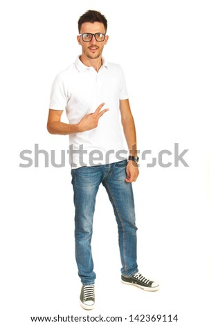 Casual man in white t-shirt with jeans showing victory sign hand gesture isolated on white background - stock photo
