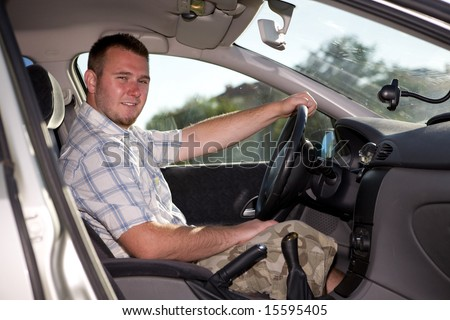 casual man inside in his car