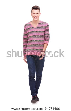 Casual Man is walking towards the camera on White . Fashion young man smiling and walking - stock photo