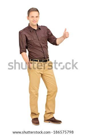 Casual man leaning against a wall and giving thumb up isolated on white background