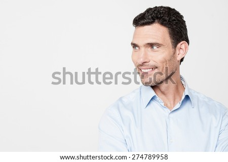 Casual man looking at something with smile