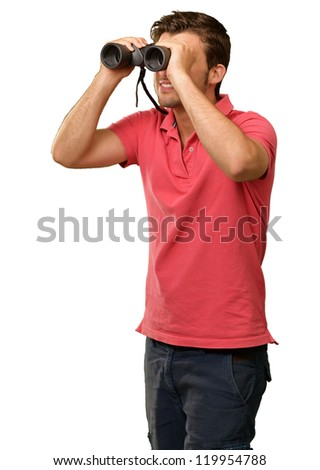 casual man looking into binocular isolated on grey background - stock photo