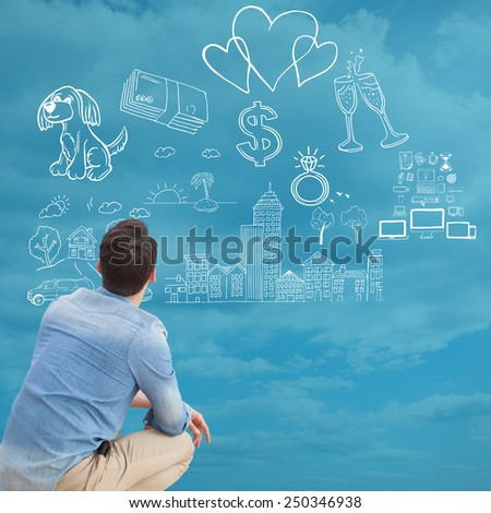 Casual man looking up against sky - stock photo