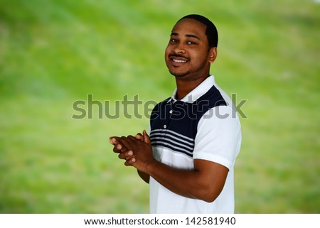 Casual man pictured standing outside of his home - stock photo